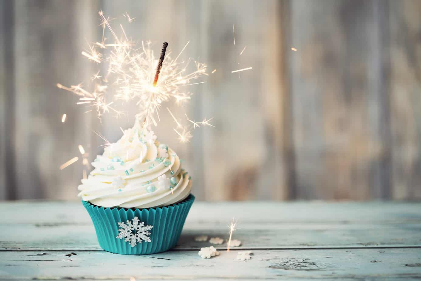 cupcake with a lit sparkler in it.
