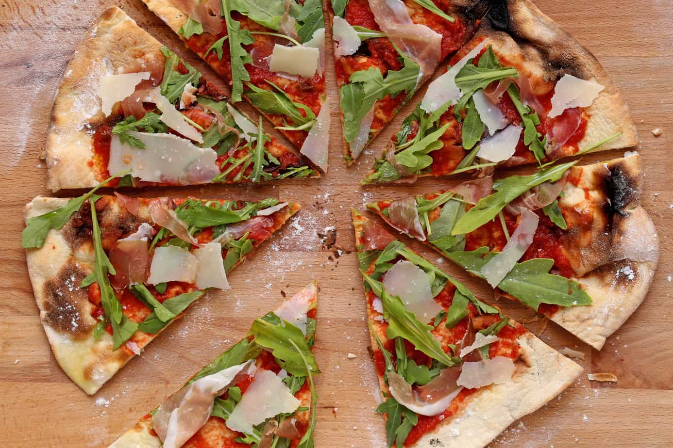 gourmet pizza on a wood cutting board