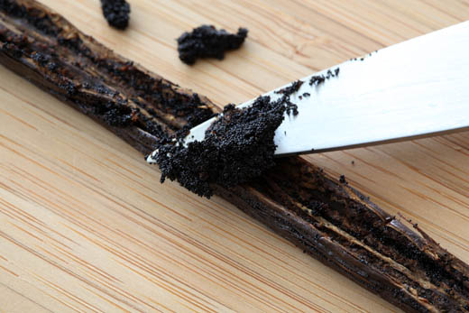 scraping out a vanilla bean with a knife